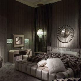 Luxury monochromatic grey room with a platform velvet bed