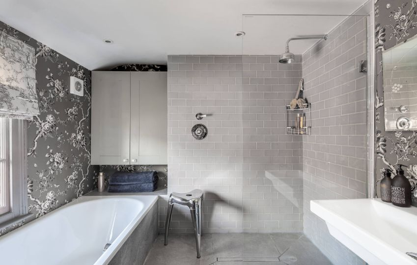 Consider gray subway tiles in the shower to maintain an open and airy look without relying on white