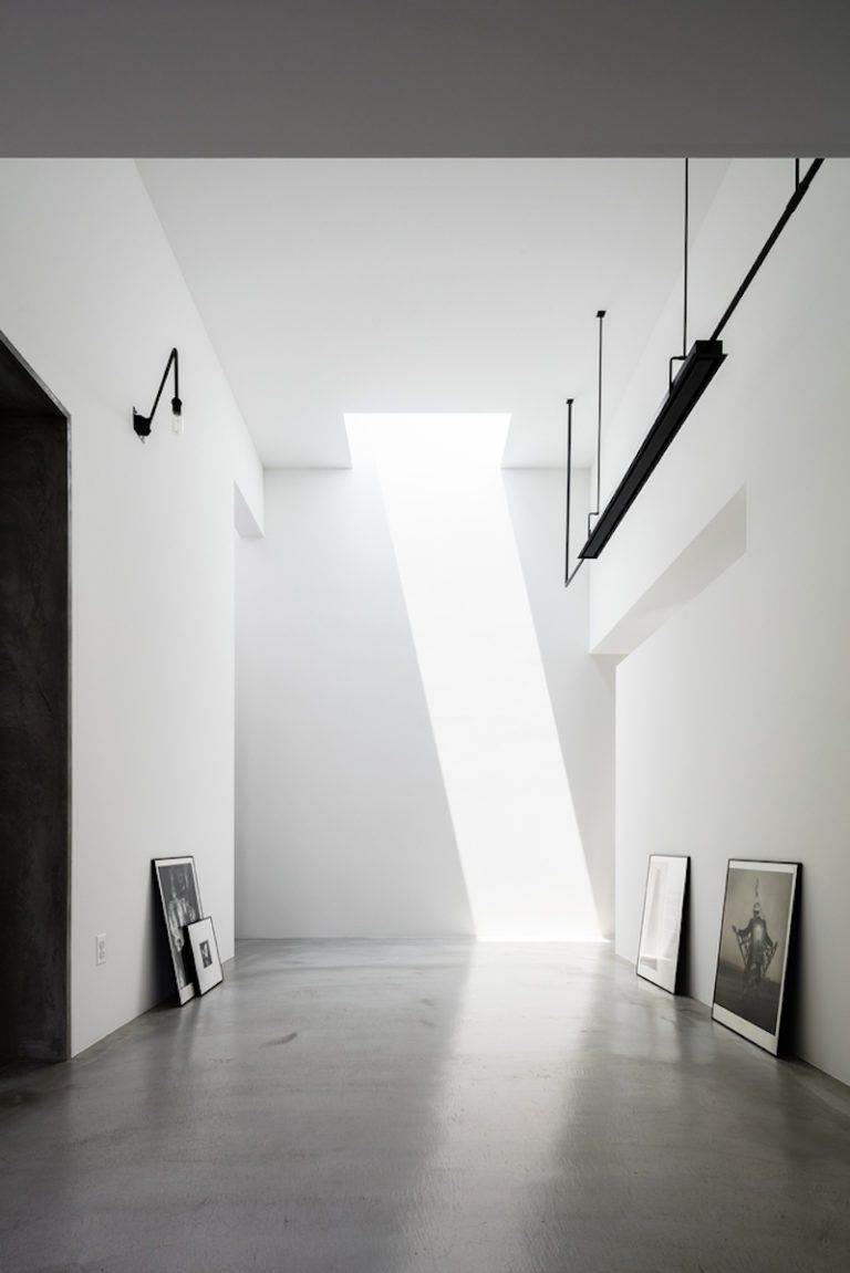 The hallway is intentionally left simple and neutral so the focus can be on the artwork