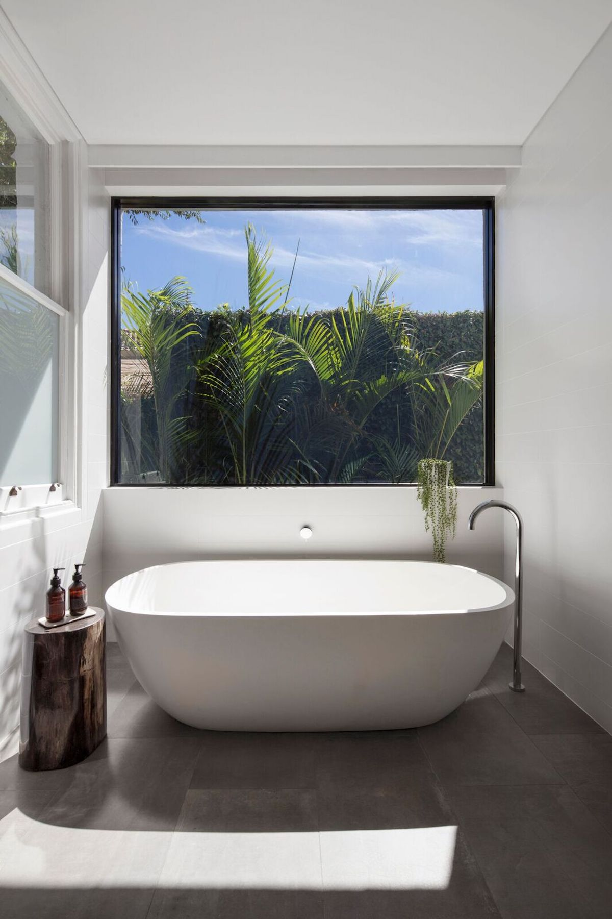The bathrooms are bathed in light as well while strategically placed plants ensure privacy