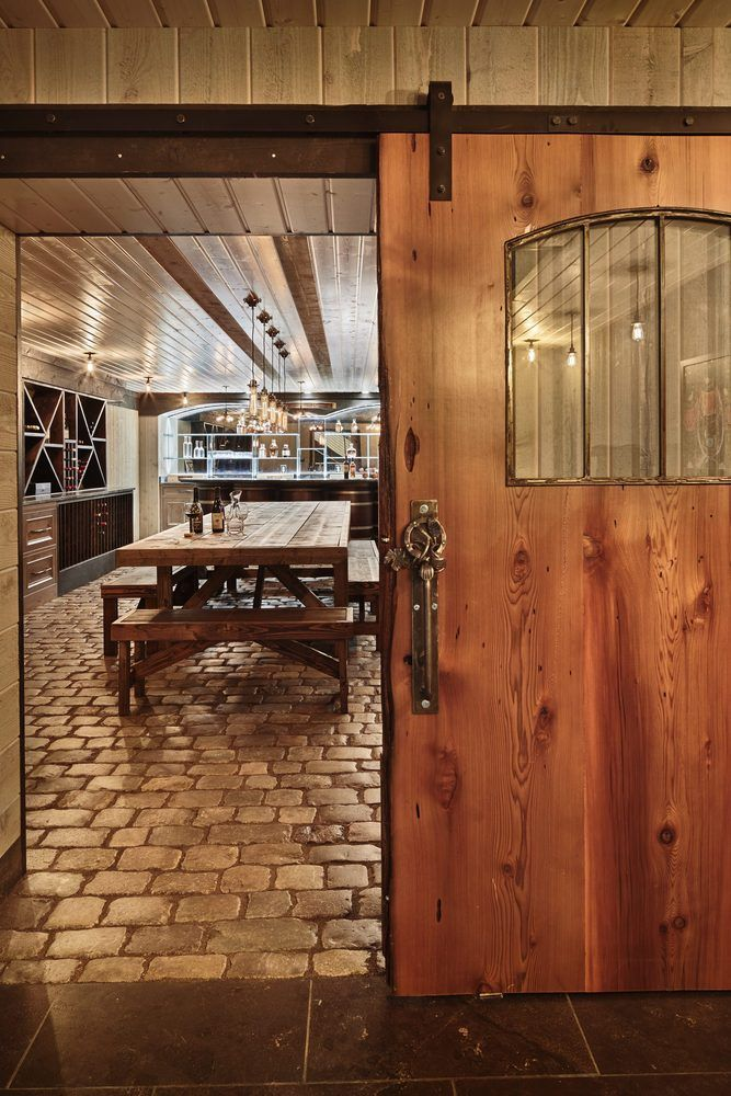 Reclaimed materials and a rustic but luxurious style distinguish this wine cellar.