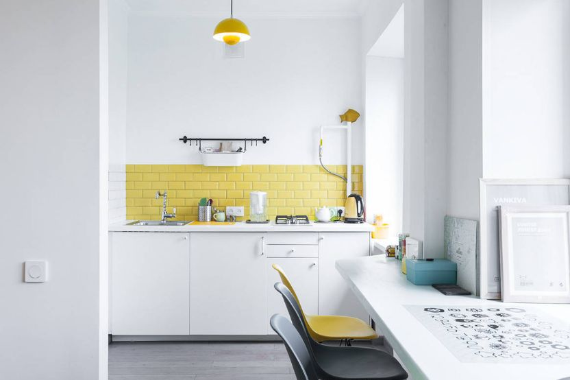 You can use white as the main color and the yellow backsplash can match a few smaller accessories in the room