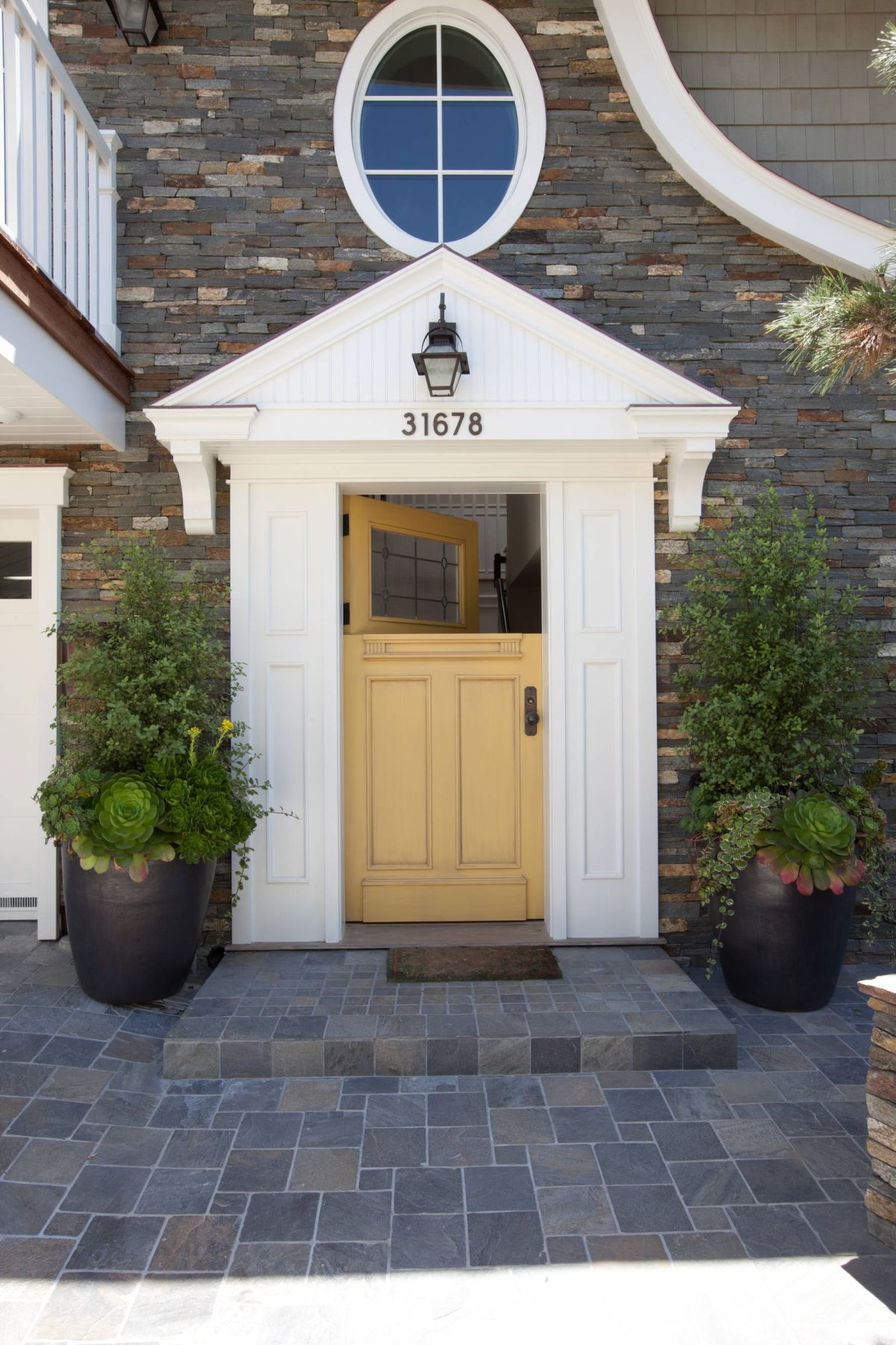 Traditional exterior yellow dutch door style