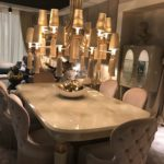 Tufted upholstered chairs for dining area - large chandelier over table