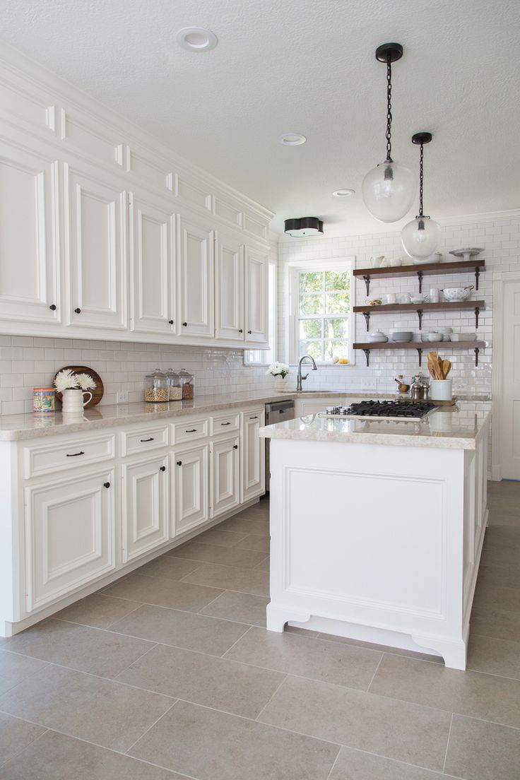 white kitchen cabinets travertine floor 18 beautiful examples of kitchen floor tile 28954