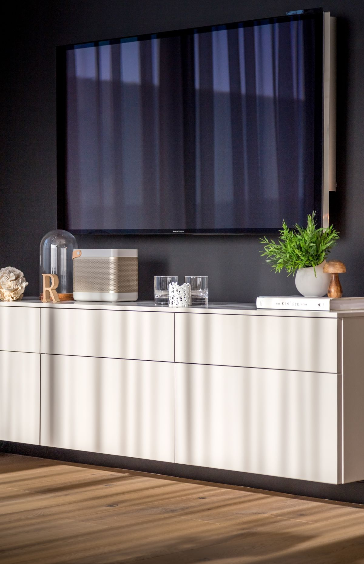 A storage cabinet is critical for hiding necessities in an open floor plan.