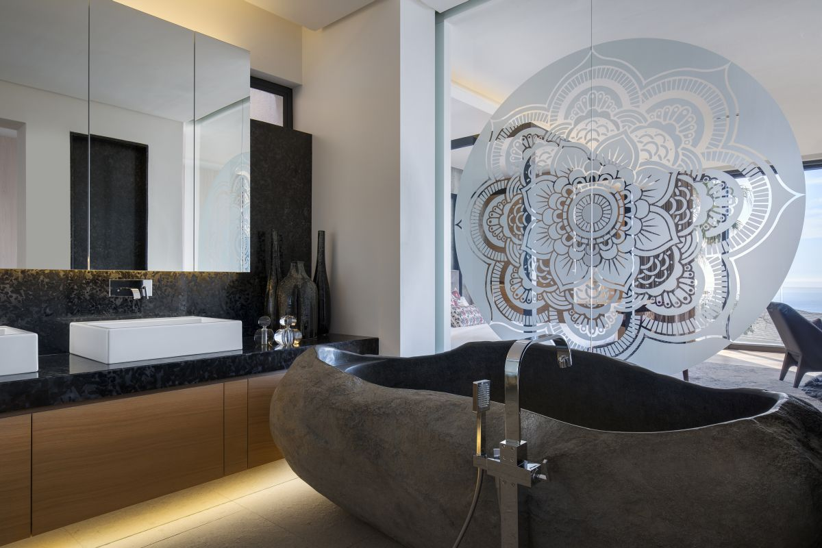 The mandala on these sliding glass doors adds sophistication to both the bathroom and the bedroom