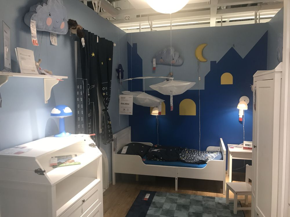 The white furniture transitions well from a baby nursery to a child's room.