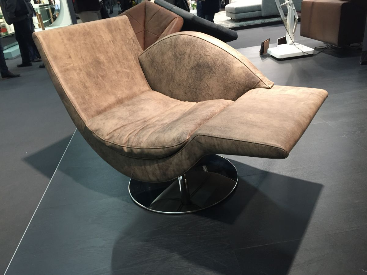 This brown leather chaise is quite masculine and has a modern shape.
