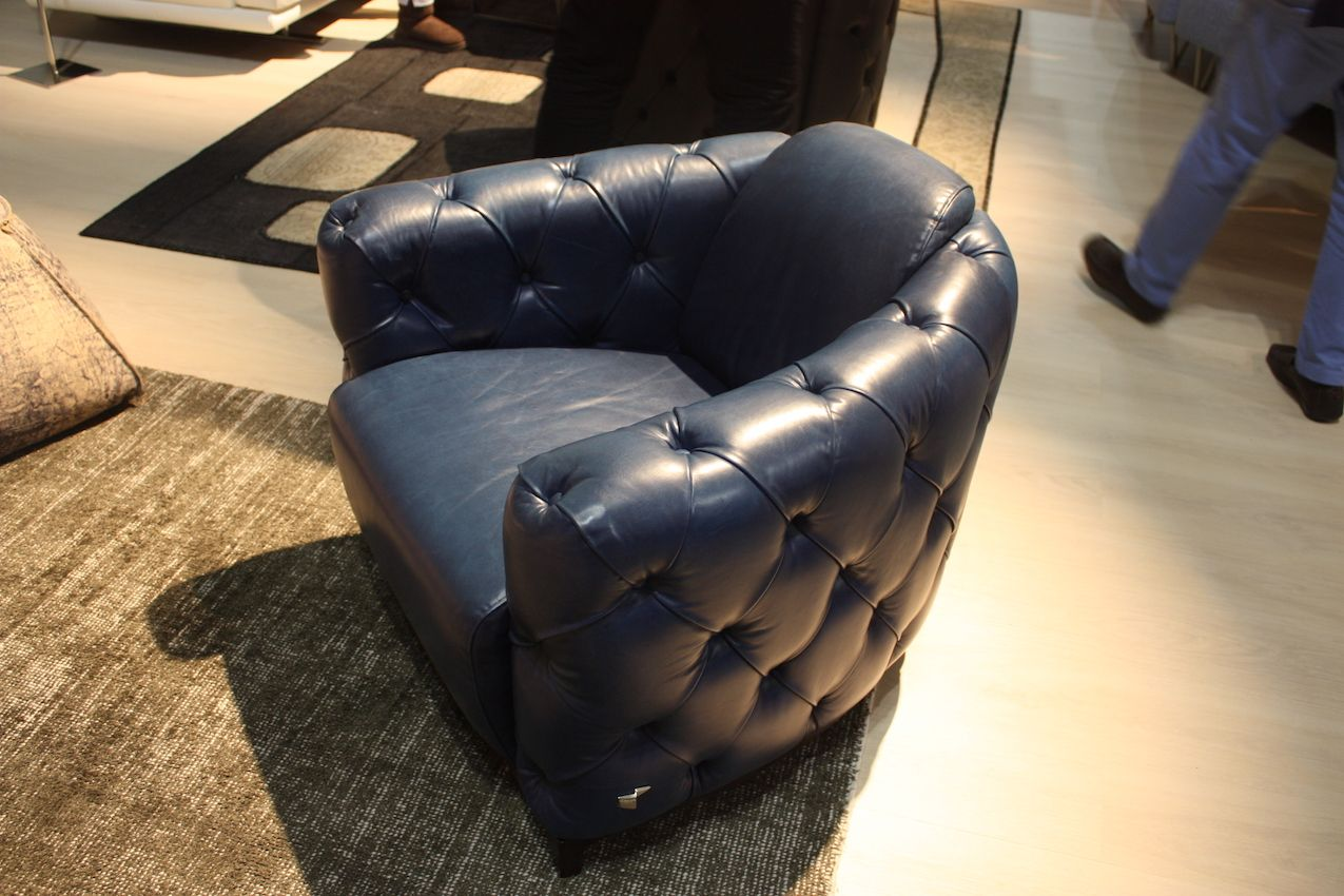 Calla Italia's leather club chair is masculine and fairly traditional.
