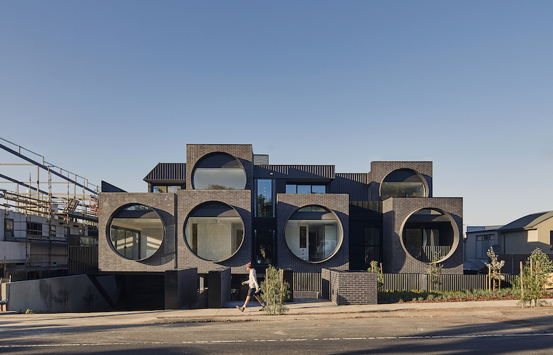 This apartment building is unlike any of its neighbors or other structure of this kind