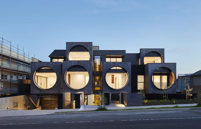 A Unique Apartment Building With Large Porthole Windows