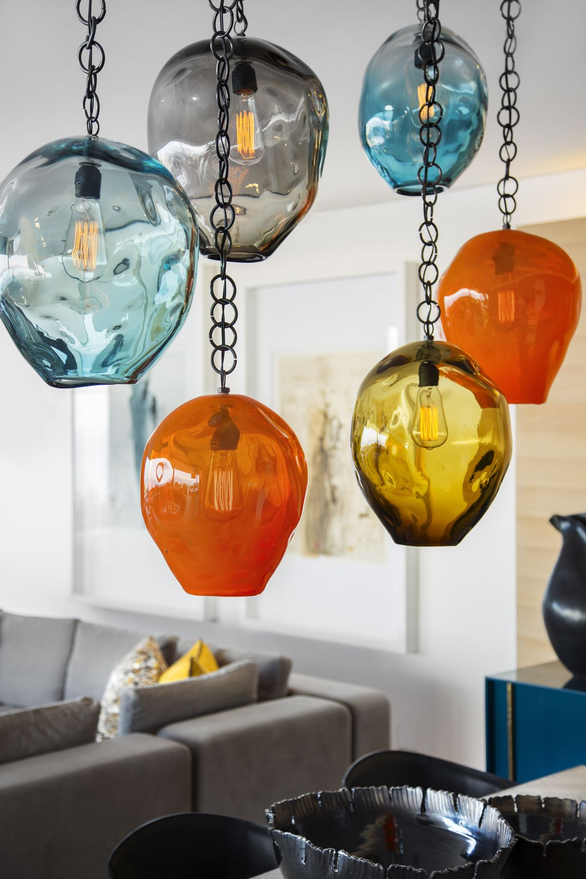 All these blown glass pendant lamps add color to the living area and make the space look playful