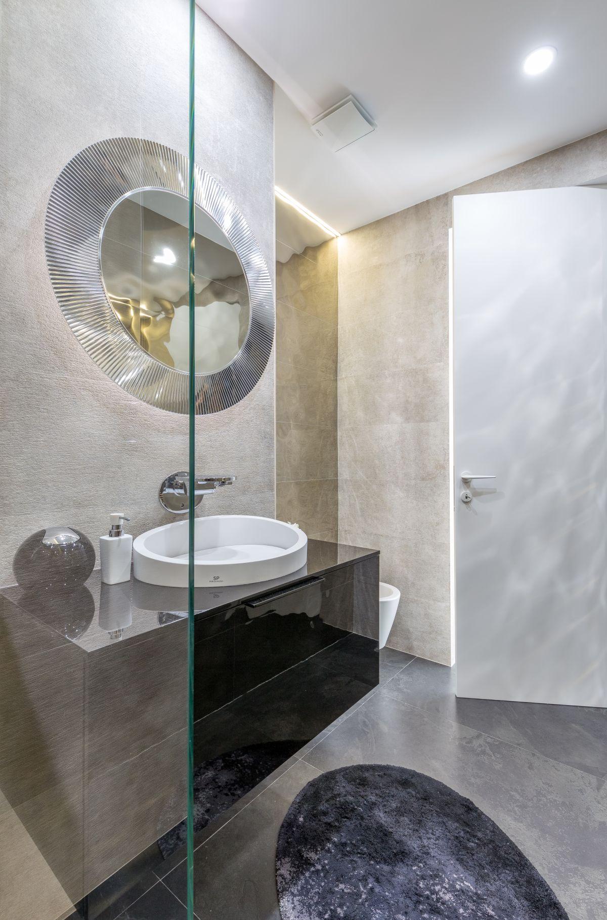 Strategic use of glass makes a bathroom feel larger.