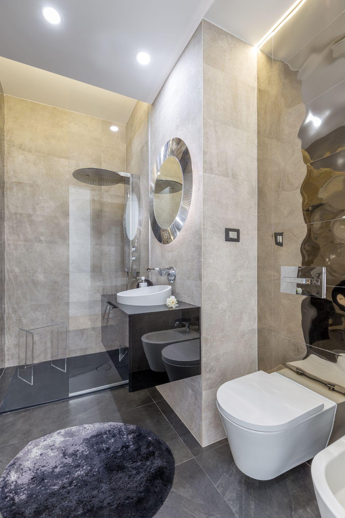 Modern bathrooms like this have plenty of shine.