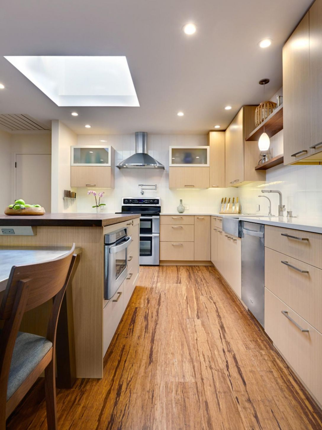 Contemporary kitchen with variation of bamboo floor
