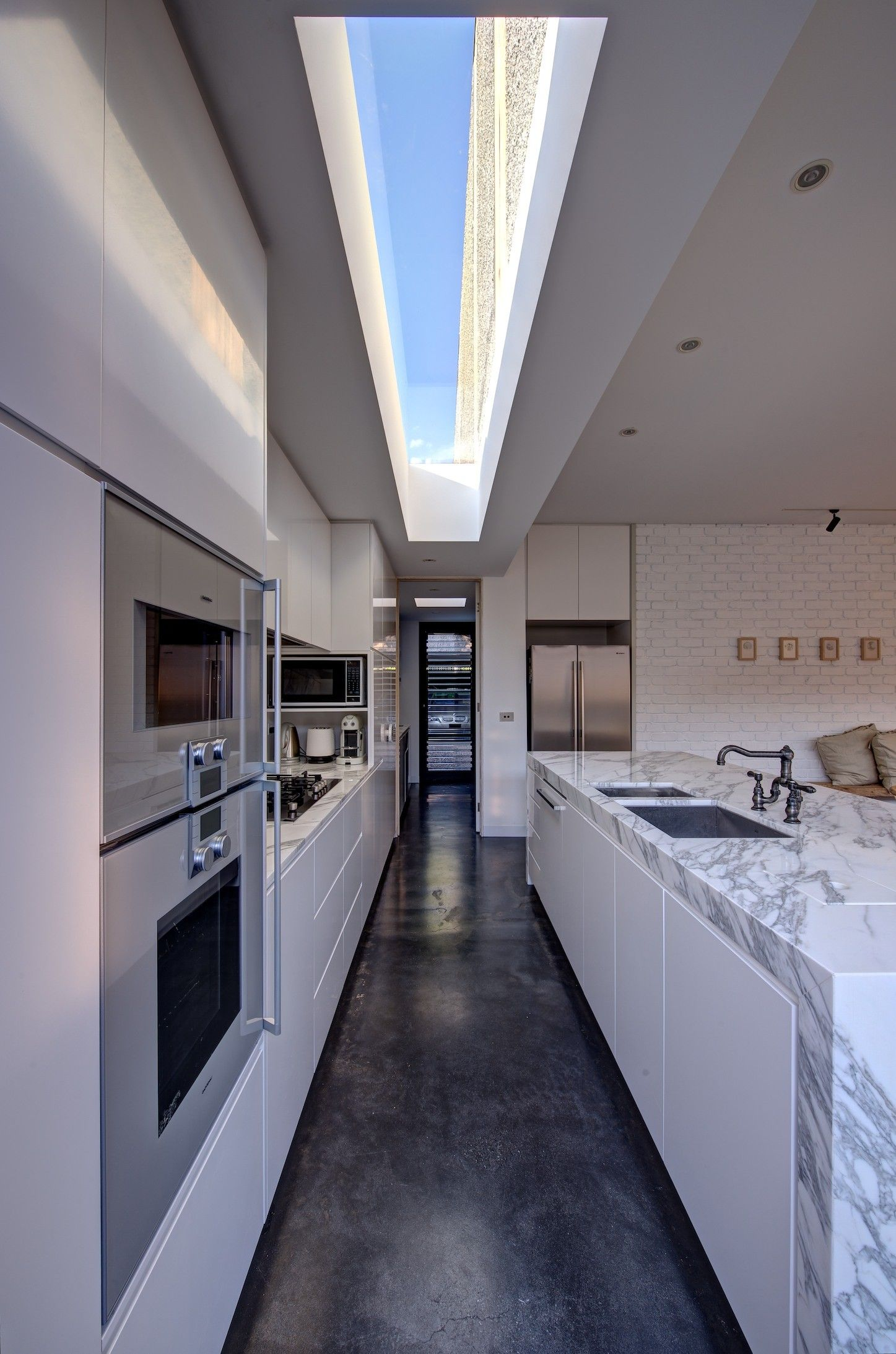 This is definitely not the best kitchen layout if you want the space to be a social area