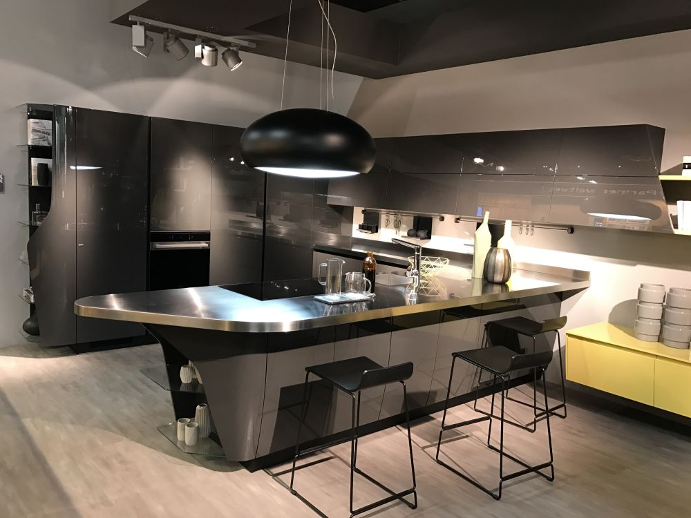 Transform one side of the kitchen into a bar and open the space to the living area