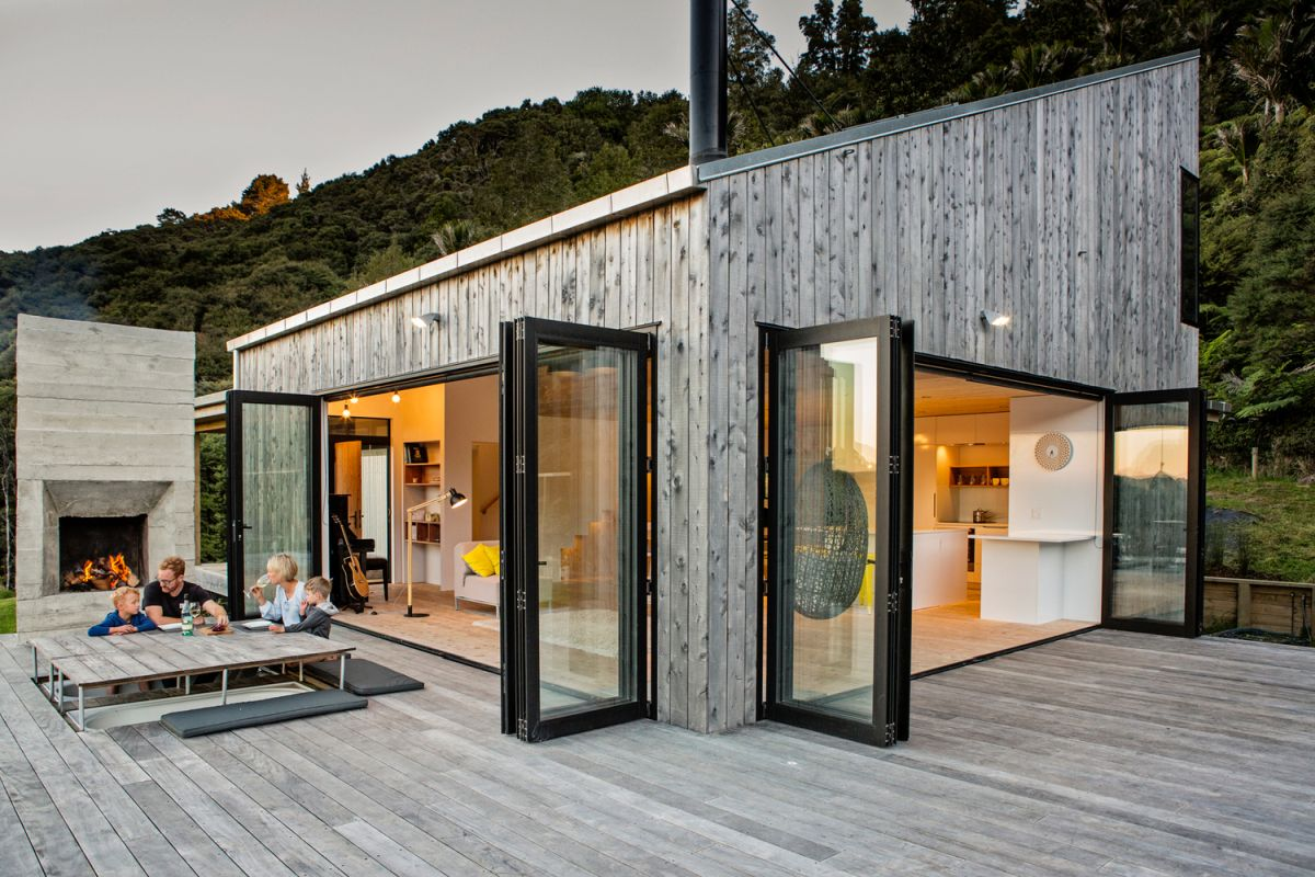 A wooden deck wraps around the living area, framing it and providing vast lounge spaces