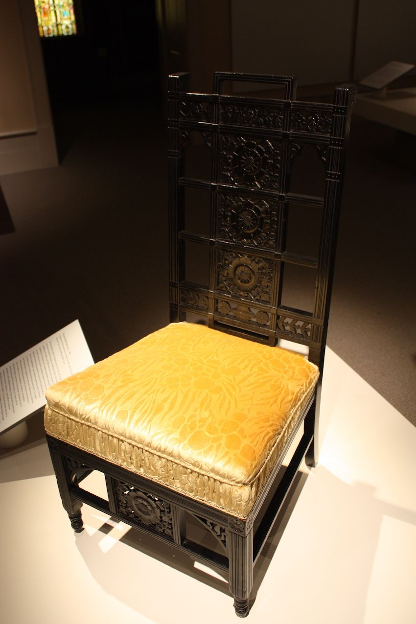 This chair does not have an upholstered back, but the seat could accommodate the era's fashionable skirts.