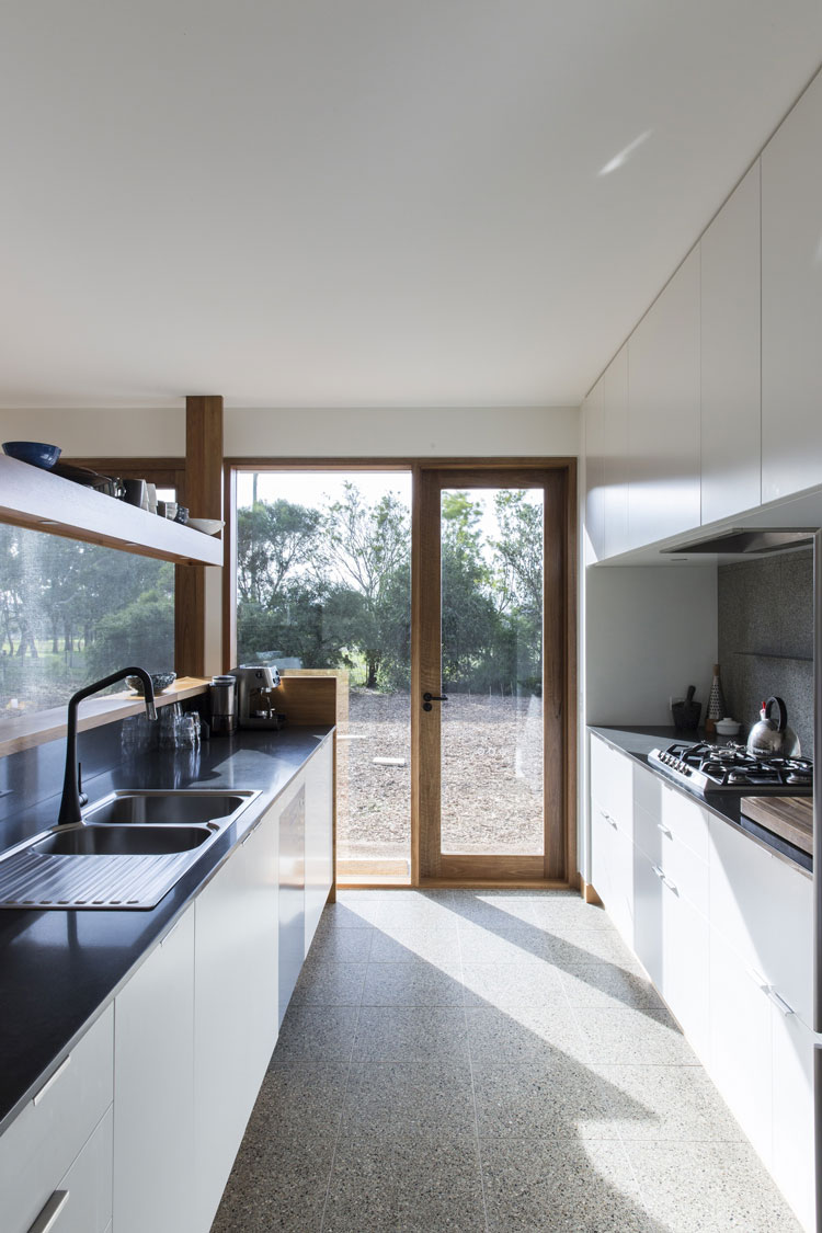 You can make a galley kitchen seem more open with a window or a sliding glass door at the end