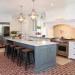 Gray kitchen island design with brown brick floor