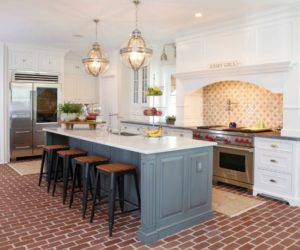 Gray kitchen island design with brown brick floor