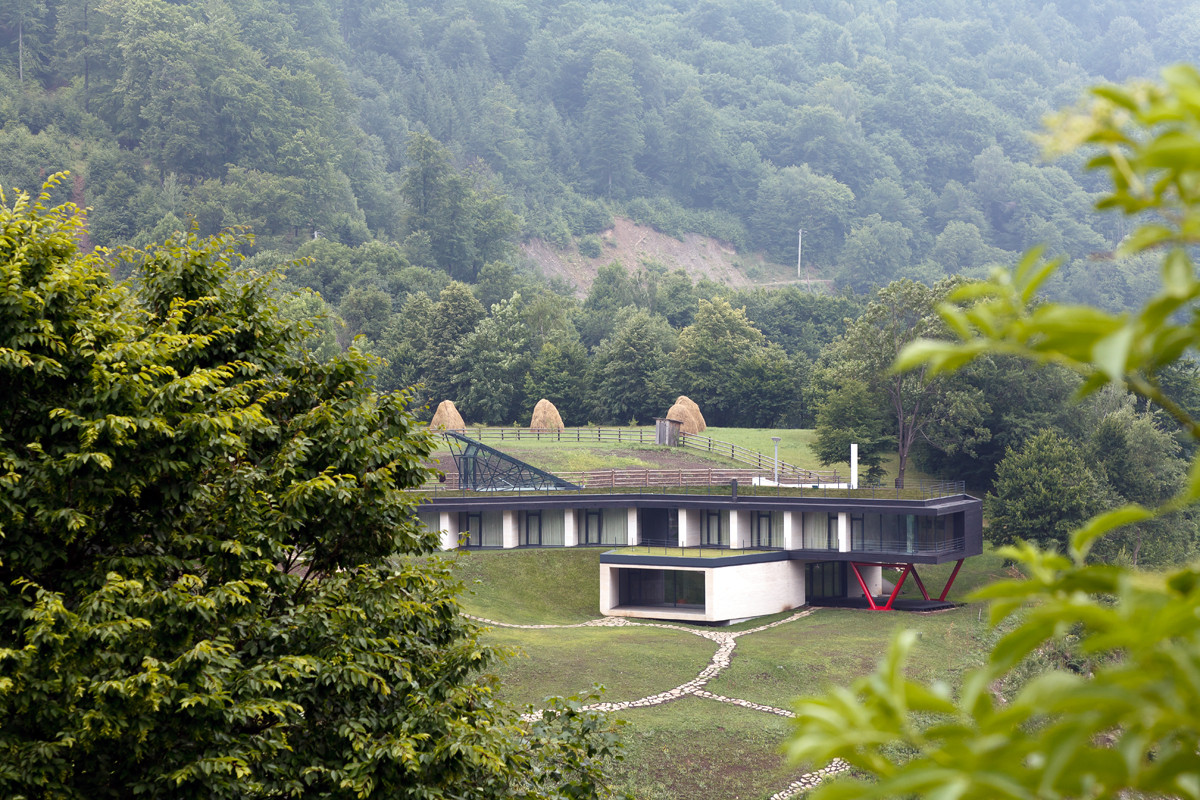 The hotel is set in a valley, surrounded by mountains, conifer forests and a lake