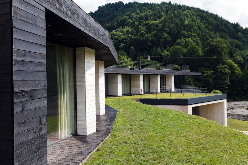 The terraced green roofs double as open terraces for the bedroom suites lined up at the top