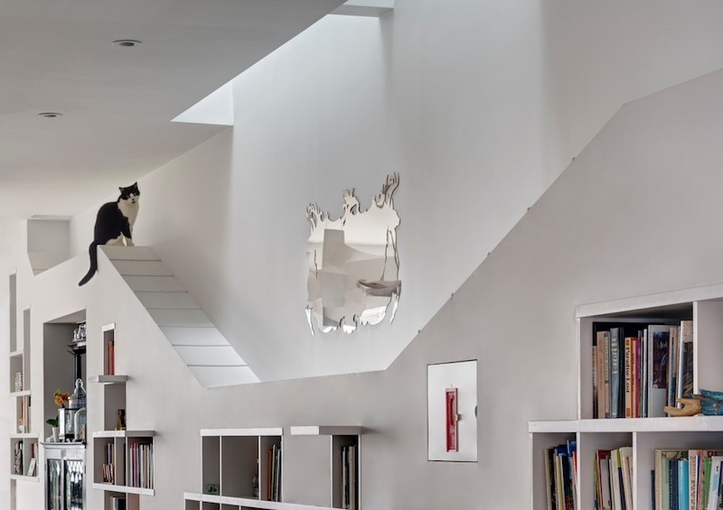 The bookcase unit has special hiding spaces for the cats and also fun platforms and seating areas