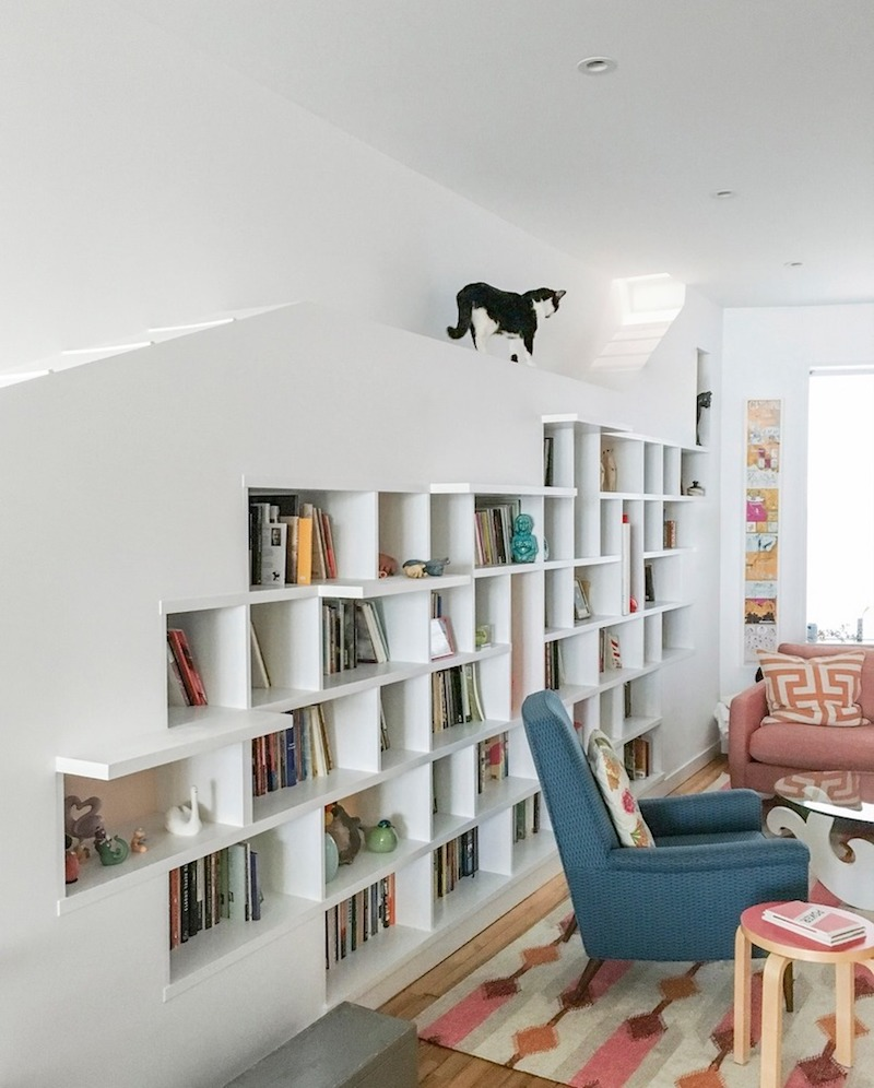 A charming home for two cats and their book loving humans in the living room theres a custom bookcase wall with ramps for the two cats amipublicfo Images