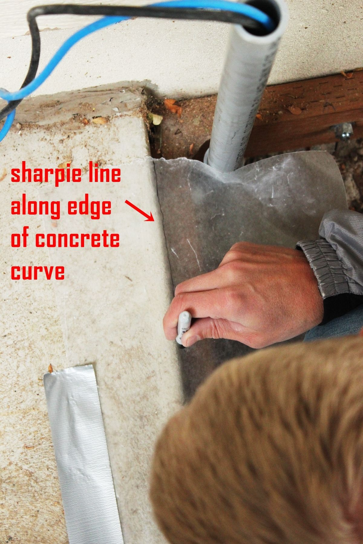 How to Install Curved Deck Floor-Use a dark permanent marker to lightly trace the edge of the curve