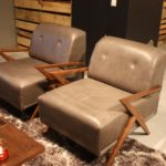 This pair of Cogswell chairs from Joybird have sharply angled armrests and leg joints.