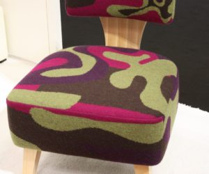 Modern slipper chairs can feature different shapes and bold upholstery.