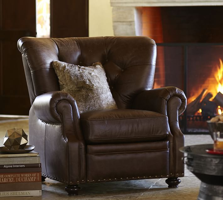 This leather easy chair has a classic, conservative shape and upholstery style.