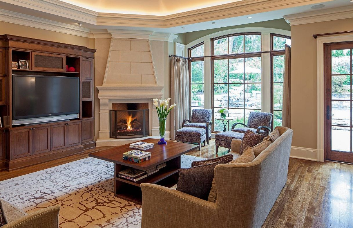 Inspiring interior designs focused on corner fireplaces for Living room with corner fireplace