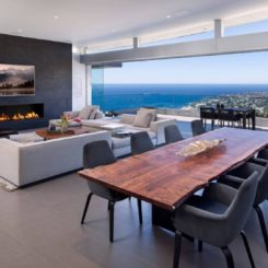Living room with large live edge dining table and spectacular views