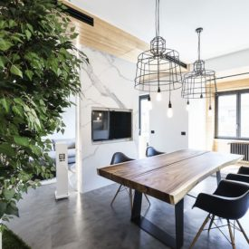 Natural wood and modern surface are paired with modern icons like the chairs.