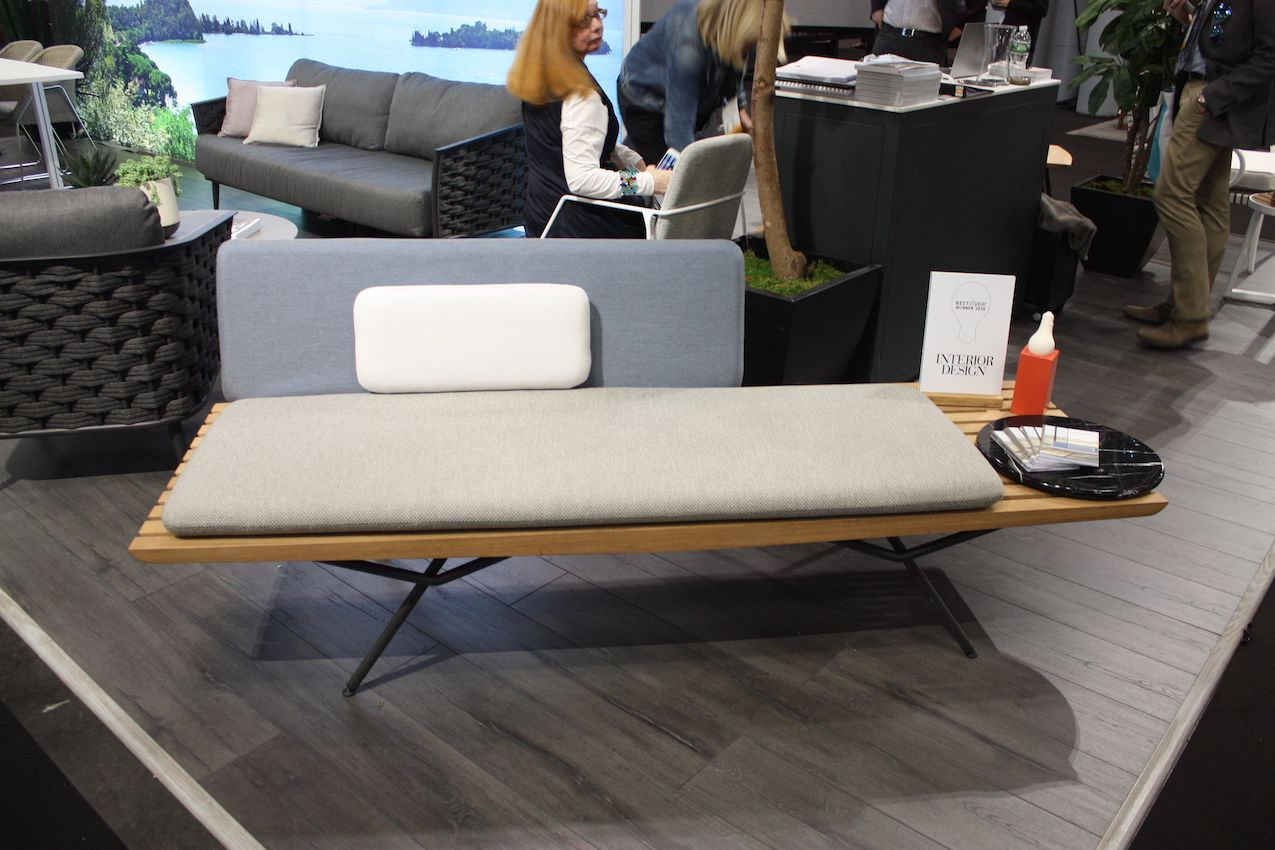 Modern style moves outdoors with this type of sofa bench.