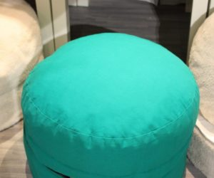 This family friendly ottoman hides a wealth of storage space.