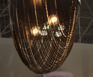 The judicious use of bling makes for a glamorous yet versatile light fixture.