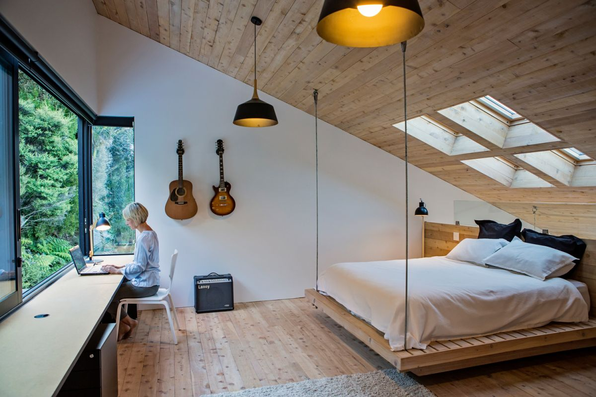 The attic bedroom has a bed that's suspended from the ceiling