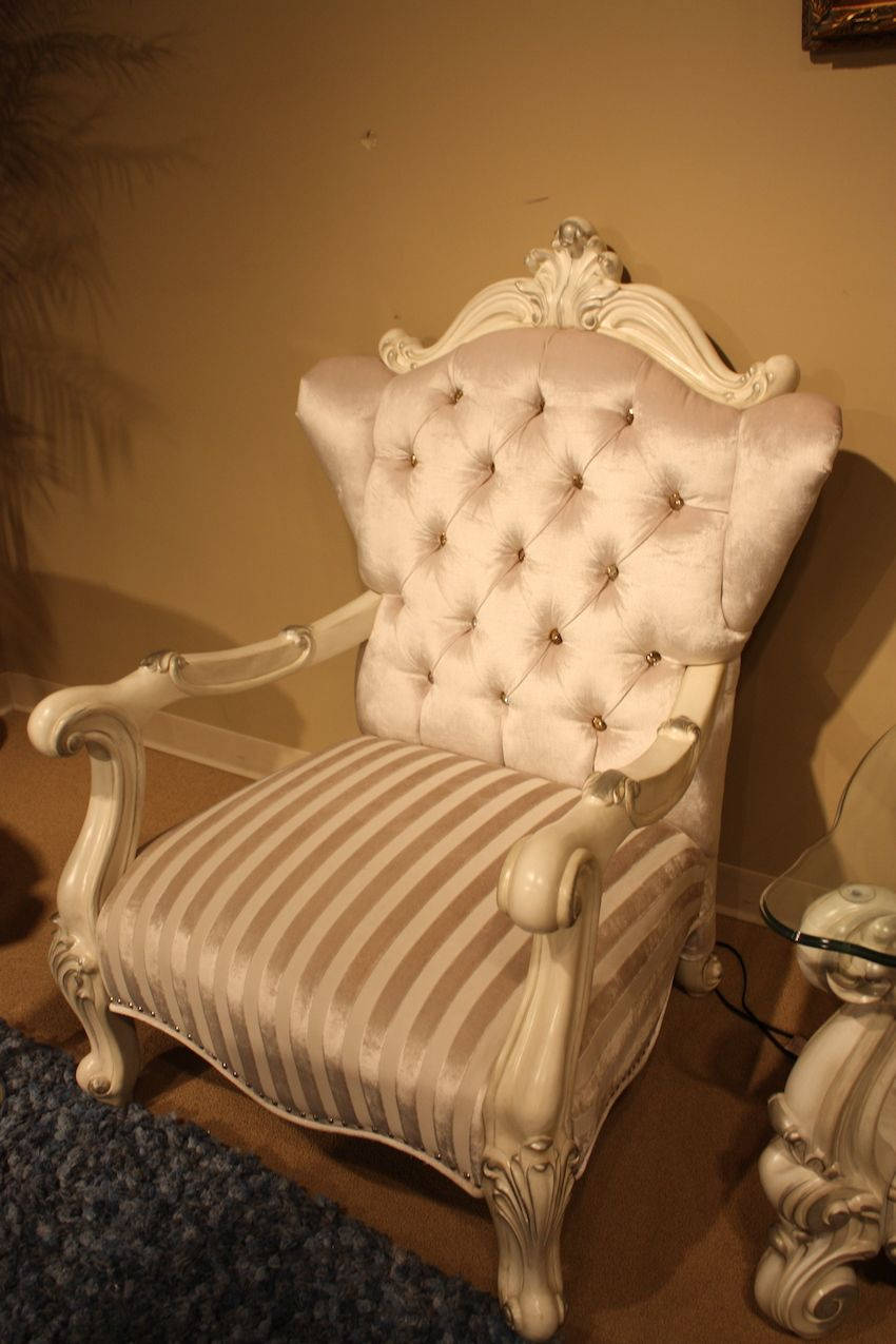 Luxury furniture often includes armchairs upholstered in silk with tufted details.