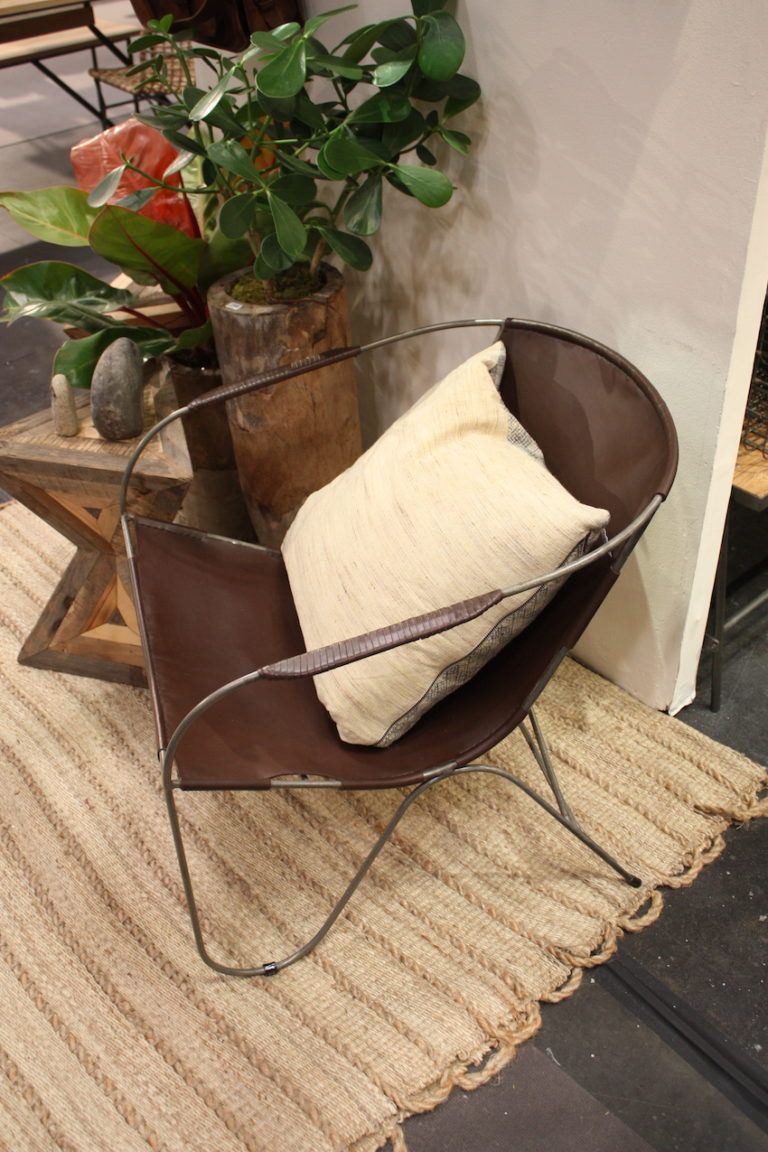 A rustic chair that features leather works well in many spaces.