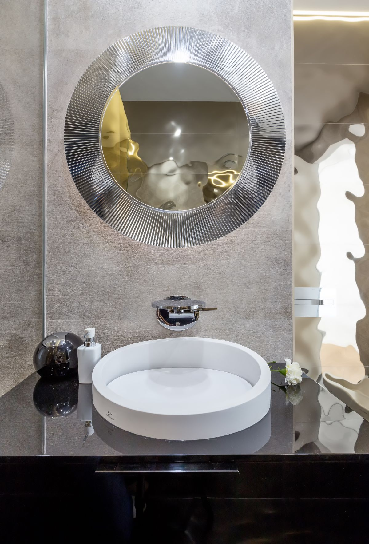 A statement mirror can become the focal point of a bathroom.