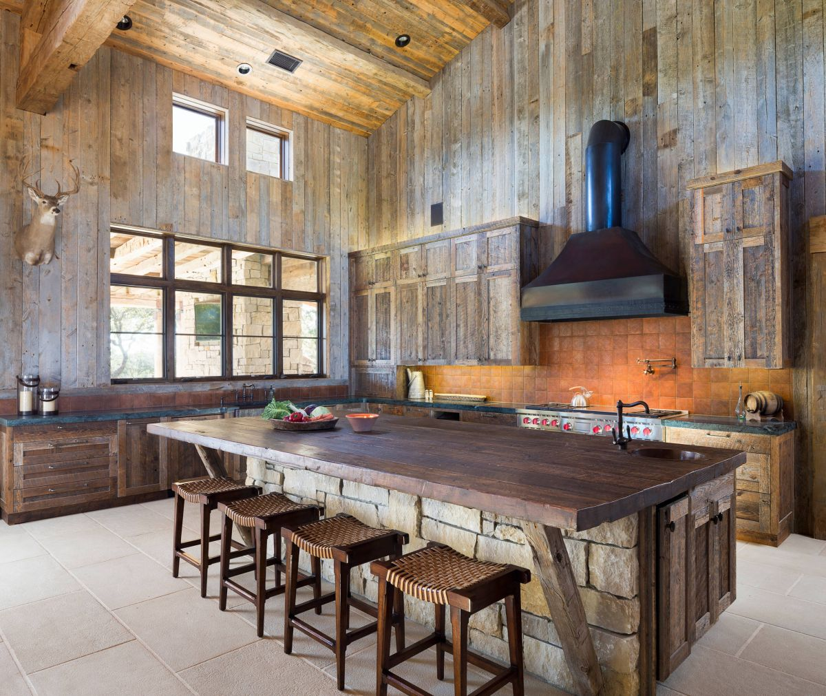 15 rustic kitchen islands perfect for any kitchen for Stone kitchen island