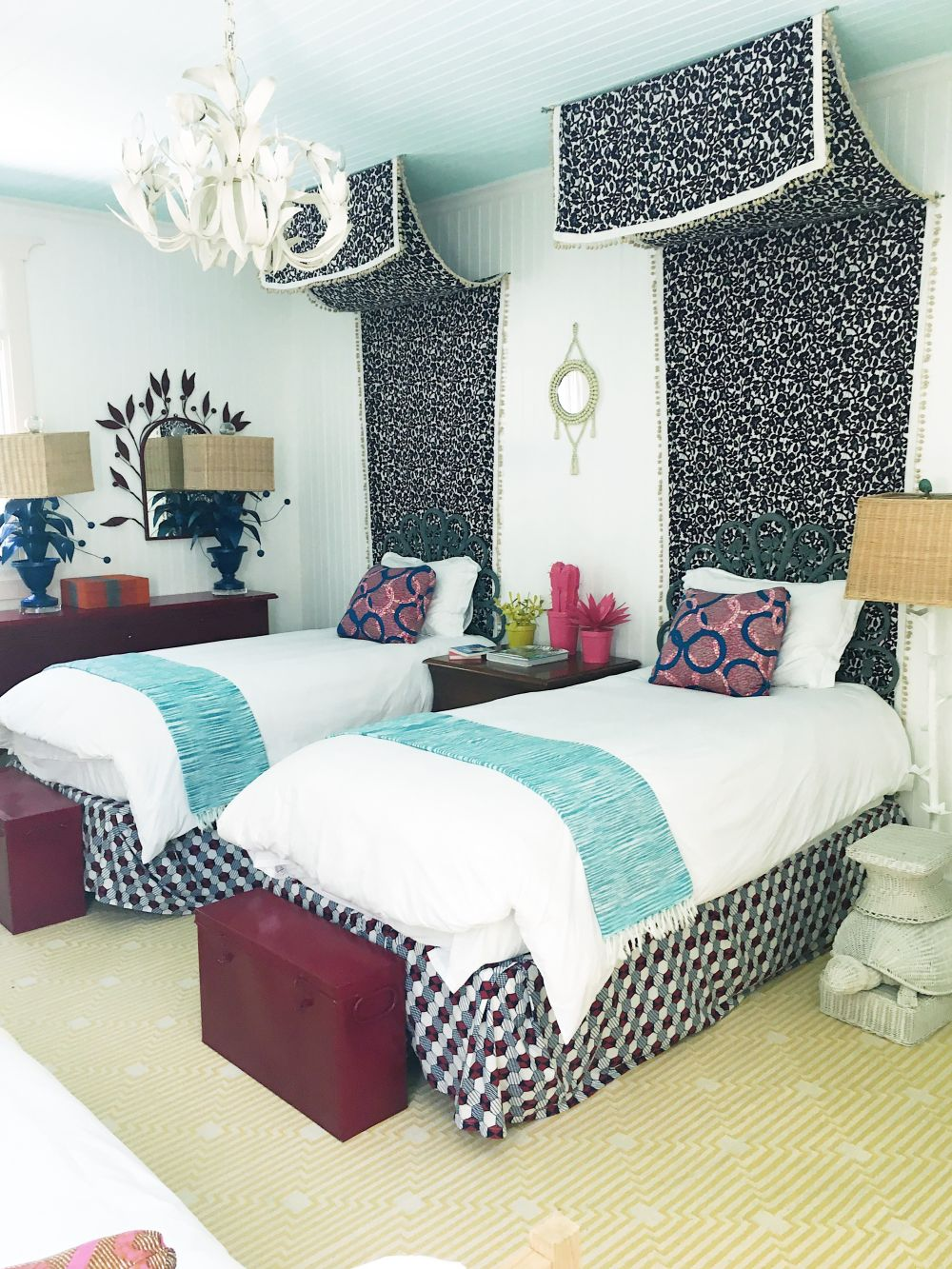 Shared bohemian bedroom with twin beds