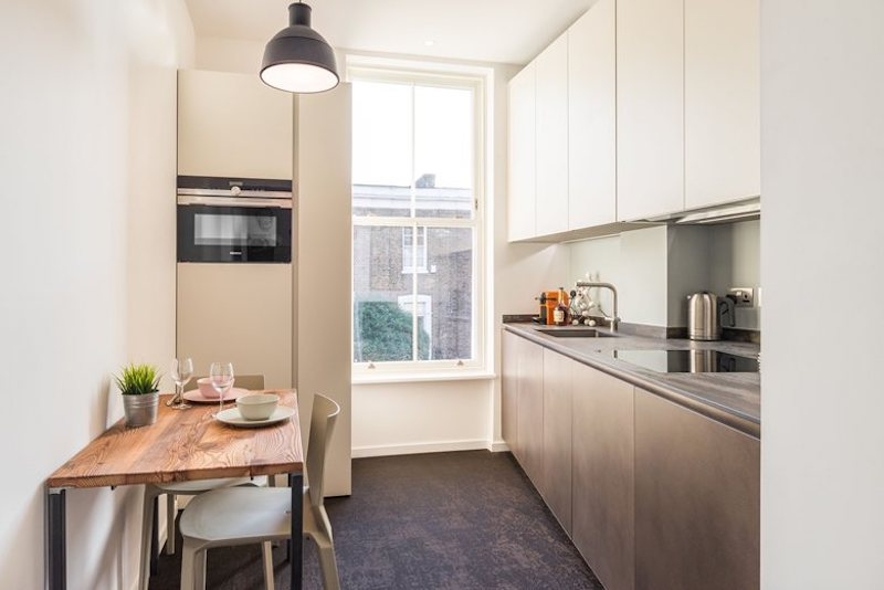 The kitchen is small and open and feels surprisingly spacious thanks to all the light that comes in