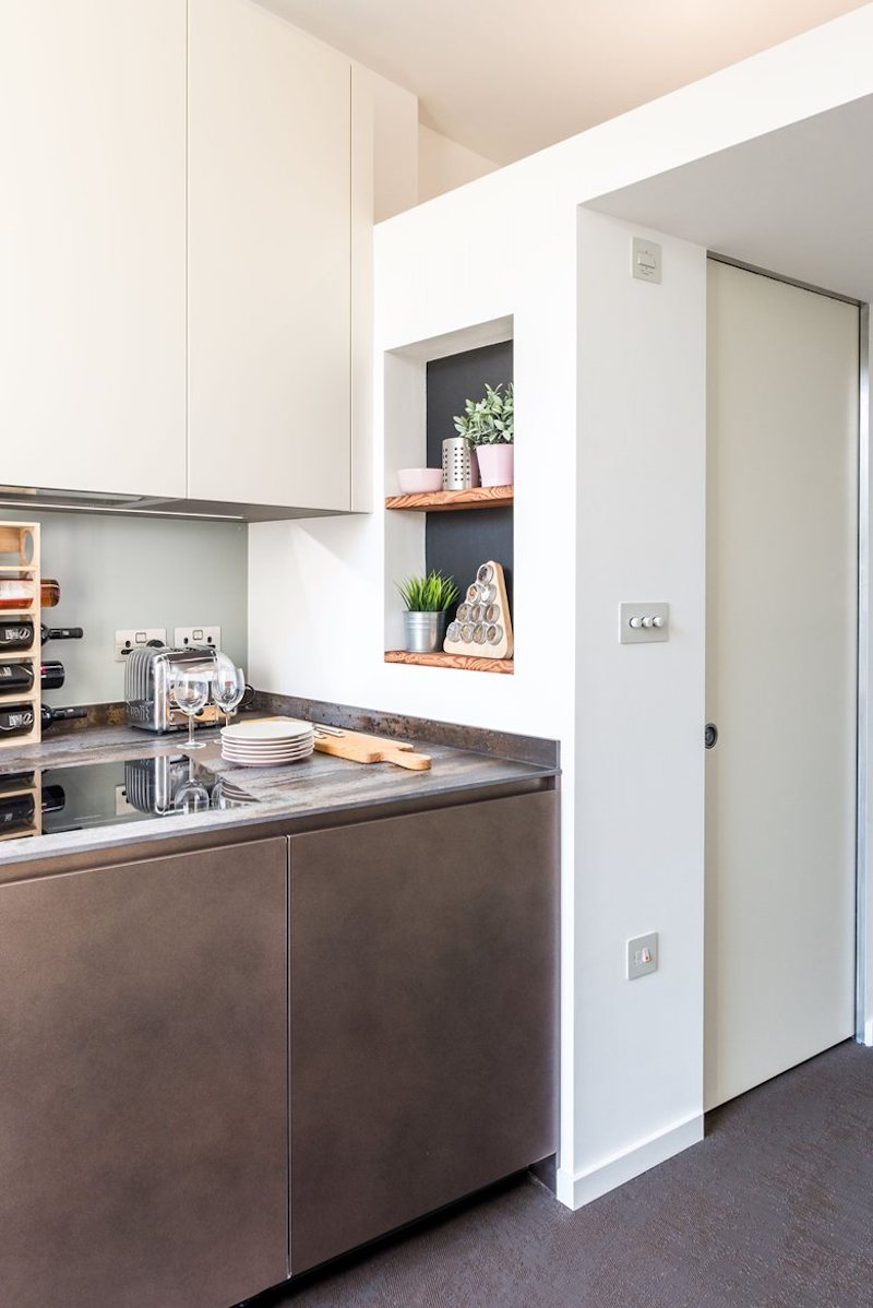 A bunch of clever storage solutions were adapted and customized specifically for this apartment