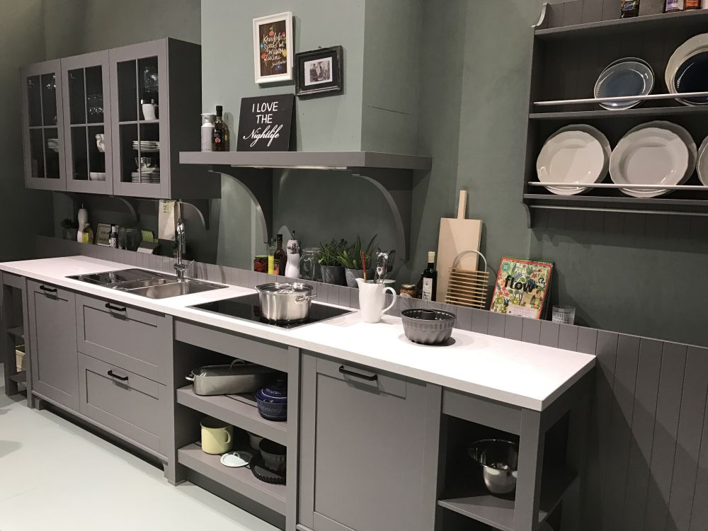 To make a small kitchen seem bigger, use open shelves, glass cabinet fronts and light colors
